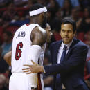 Miami Heat's LeBron James (6) walks past coach Erik Spoelstra after James was charged with an offensive foul against the Washington Wizards during the first half of an NBA basketball game, Monday, March 10, 2014, in Miami. (AP Photo/J Pat Carter)