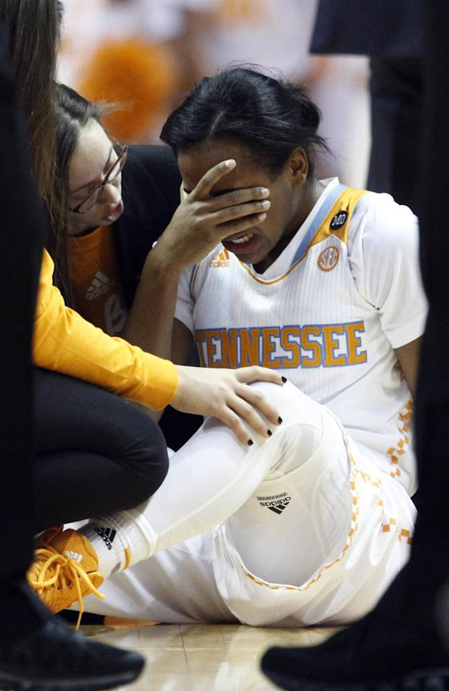 Tennessee guard Ariel Massengale (5) covers her face after being injured in the first half of an NCAA college basketball game against Florida, Thursday, Jan. 23, 2014, in Knoxville, Tenn. Massengale didn't return to the game after getting hit in the face while making a steal late in the first half. No. 11 Tennessee defeated Florida 89-69