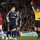 FILE - In this Wednesday, April 7, 2010 file photo, Manchester United's Rafael Da Silva, left, is sent off by referee Nicola Rizzoli, right, during their Champions League quarterfinal second leg soccer match against Bayern Munich at Old Trafford Stadium, Manchester, England. It has been announced on Monday, May 20, 2013 that  Rizzoli will referee the 2013 Champions League final between Borussia Dortmund and FC Bayern Mnchen, to be played at Wembley on Saturday.  (AP Photo/Matthias Schrader, File)