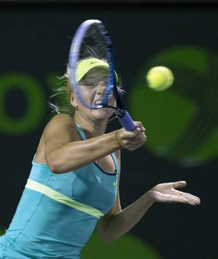 Maria Sharapova, of Russia, returns to Klara Zakopalova, of the Czech Republic, during the Sony Open Tennis tournament in Key Biscayne, Fla., Monday, March 25, 2013