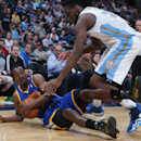 Golden State Warriors guard Jordan Crawford, left, recovers loose ball in front of Denver Nuggets forward Kenneth Faried in the fourth quarter of the Warriors' 116-112 victory in an NBA basketball game in Denver on Wednesday, April 16, 2014 The Associated