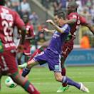 RSC Anderlecht Matias Suarez, left, is challenged by SV Zulte Waregem Bernard Malanda-Adje, during the final of the Belgian League soccer match at the Constant Vanden Stock stadium in Brussels, Sunday, May 19, 2012. (AP Photo/Yves Logghe)