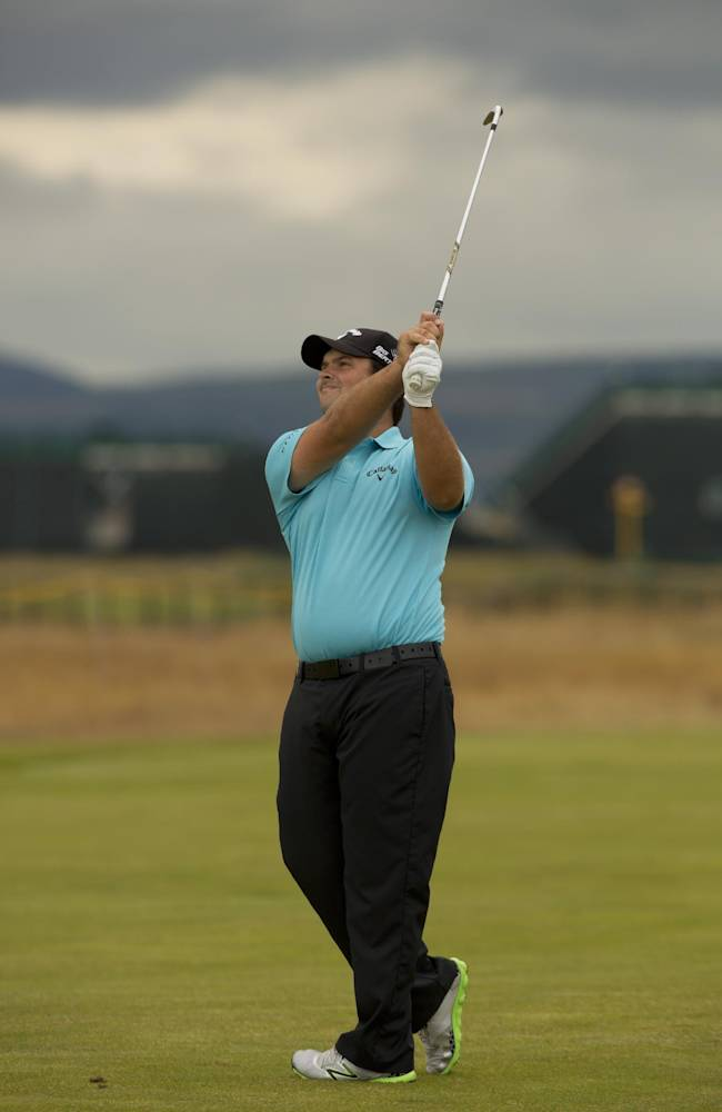 Patrick Reed of the US watches his shot on the 2nd fairway during a practice round at Royal Liverpool Golf Club prior to the start of the British Open Golf Championship, in Hoylake, England, Saturday, July 12, 2014. The 2014 Open Championship starts on Thursday July 17