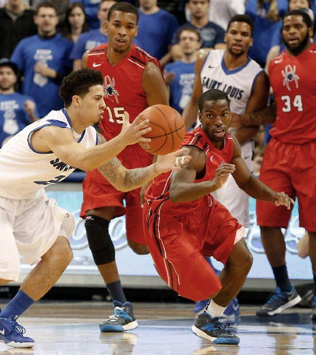 Saint Louis' Austin McBroom (2) and Richmond's Kendall Anthony (0) go after a loose ball during the first half of an NCAA college basketball game Wednesday, Jan. 29, 2014, in St. Louis