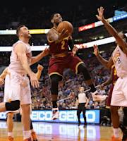 PHOENIX, AZ - MARCH 12: Kyrie Irving #2 of the Cleveland Cavaliers lays up a shot against Channing Frye #8 of the Phoenix Suns during the first half of the NBA game at US Airways Center on March 12, 2014 in Phoenix, Arizona. (Photo by Christian Petersen/Getty Images)