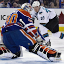 San Jose Sharks' Logan Couture (39) hits the post as Edmonton Oilers' Devan Dubnyk (40) looks for the puck during the first period of an NHL hockey game, Friday, Nov. 15, 2013 in Edmonton, Alberta The Associated Press