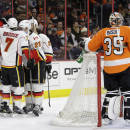 Calgary Flames' Sean Monahan (23) celebrates with teammate after scoring a goal against Philadelphia Flyers' Steve Mason (35) during the first period of an NHL hockey game Tuesday, March 3, 2015, in Philadelphia. (AP Photo/Matt Slocum)