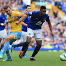 Everton's Samuel Eto'o, right, and Crystal Palace's James McArthur battle for the ball during their English Premier League soccer match at Goodison Park, Liverpool, England, Sunday, Sept. 21, 2014
