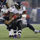 New England Patriots strong safety Patrick Chung (23) tackles Baltimore Ravens wide receiver Steve Smith (89) in the first half of an NFL divisional playoff football game Saturday, Jan. 10, 2015, in Foxborough, Mass The Associated Press