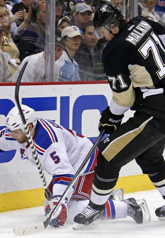 Pittsburgh Penguins' Evgeni Malkin (71) collides with New York Rangers' Dan Girardi (5) in the second period of game 2 of a second-round NHL playoff hockey series in Pittsburgh Sunday, May 4, 2014