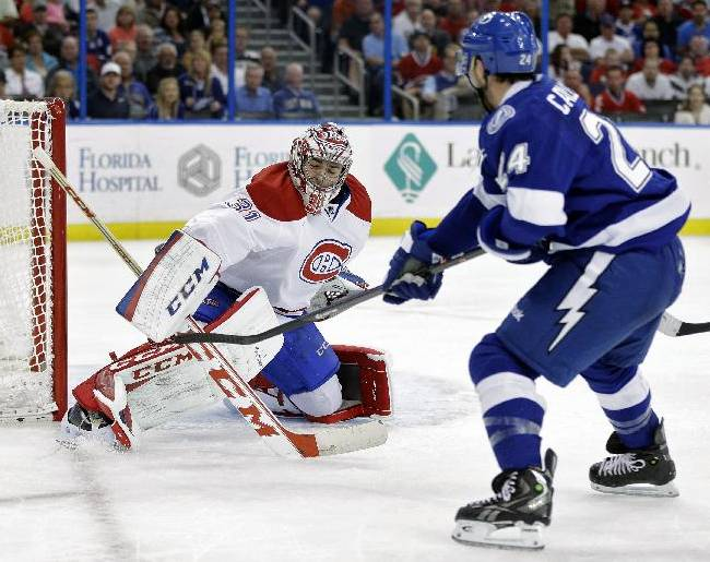 Montreal Canadiens goalie Carey Price (31) can't get his blocker on a goal by Tampa Bay Lightning right wing Ryan Callahan (24) during the second period of an NHL hockey game Tuesday, April 1, 2014, in Tampa, Fla