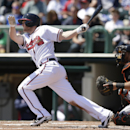 Atlanta Braves second baseman Tyler Pastornicky follows through on a two-run single to center field during the first inning of an exhibition baseball game against the Miami Marlins in Kissimmee, Fla., Wednesday, March 26, 2014 The Associated Press