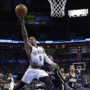 Oklahoma City Thunder guard Russell Westbrook (0) is fouled by Indiana Pacers center Roy HIbbert (55) as he shoots in the third quarter of an NBA basketball game in Oklahoma City, Sunday, Dec. 8, 2013. Oklahoma City won 118-94. (AP Photo/Sue Ogrocki)