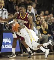 VCU guard Briante Weber, front, dives to keep the ball inbounds during the first half of an NCAA college basketball game in Richmond, Va., Saturday, Nov. 16, 2013. (AP Photo/Zach Gibson)