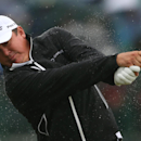Rain bounces off Jason Dufner of the US as he plays a shot off the 4th tee during the third day of the British Open Golf championship at the Royal Liverpool golf club, Hoylake, England, Saturday July 19, 2014. (AP Photo/Jon Super)