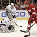 Detroit Red Wings' Riley Sheahan (15) takes a shot against Los Angeles Kings goalie Jonathan Quick (32) during the second period of an NHL hockey game, Friday, Oct. 31, 2014, in Detroit. The Red Wings defeated the Kings 5-2. (AP Photo/Duane Burleson)