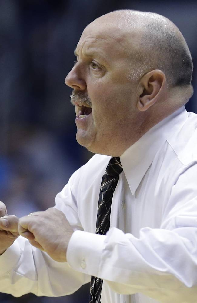 Quincy head coach Marty Bell works on the sidelines on the first half of an NCAA exhibition college basketball game against Xavier, Saturday, Nov. 2, 2013, in Cincinnati
