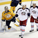 Columbus Blue Jackets right wing Jared Boll, center, celebrates with right wing Jerry D'Amigo (25) after Boll scored against Nashville Predators goalie Pekka Rinne, left, of Finland, in the third period of a preseason NHL hockey game Monday, Sept. 29, 201