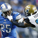 Jacksonville Jaguars cornerback Jeremy Harris (31) grabs Detroit Lions running back Mikel Leshoure's (25) face mask in the second half of a preseason NFL football game at Ford Field in Detroit, Friday, Aug. 22, 2014 The Associated Press