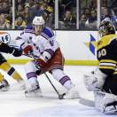 New York Rangers left wing Carl Hagelin (62) beats Boston Bruins defenseman Johnny Boychuk (55) for an unsuccessful bid against goalie Tuukka Rask (40) during the third period in Game 2 of the NHL Eastern Conference semifinal hockey playoff series in Boston, Sunday, May 19, 2013. The Bruins won 5-2. (AP Photo/Elise Amendola)