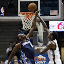 Milwaukee Bucks' Larry Sanders shoots over Charlotte Bobcats' Bismack Biyombo during the first half of an NBA basketball game Monday, April 1, 2013, in Milwaukee. (AP Photo/Tom Lynn)