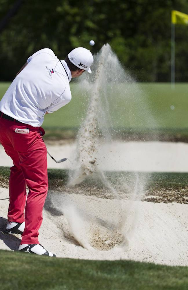 Keegan Bradley hits out of a bunker on the eighth hole during the second round of the Houston Open golf tournament on Friday, April 4, 2014, in Humble, Texas