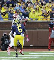 Indiana wide receiver Cody Latimer, top, catches a first quarter touchdown pass over Michigan's Raymon Taylor during an NCAA football game at Michigan Stadium in Ann Arbor, Saturday, Oct. 19, 2013. (AP Photo/Lon Horwedel)