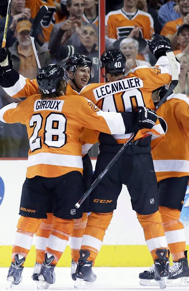 From left to right, Philadelphia Flyers' Claude Giroux, Brayden Schenn, Vincent Lecavalier and Matt Read celebrate after Schenn's goal during the first period of an NHL hockey game against the Toronto Maple Leafs, Wednesday, Oct. 2, 2013, in Philadelphia, Pa