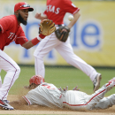 Philadelphia Phillies' Ben Revere steals second as Texas Rangers shortstop Elvis Andrus catches the ball during the fourth inning of an opening day baseball game at Globe Life Park, Monday, March 31, 2014, in Arlington, Texas The Associated Press