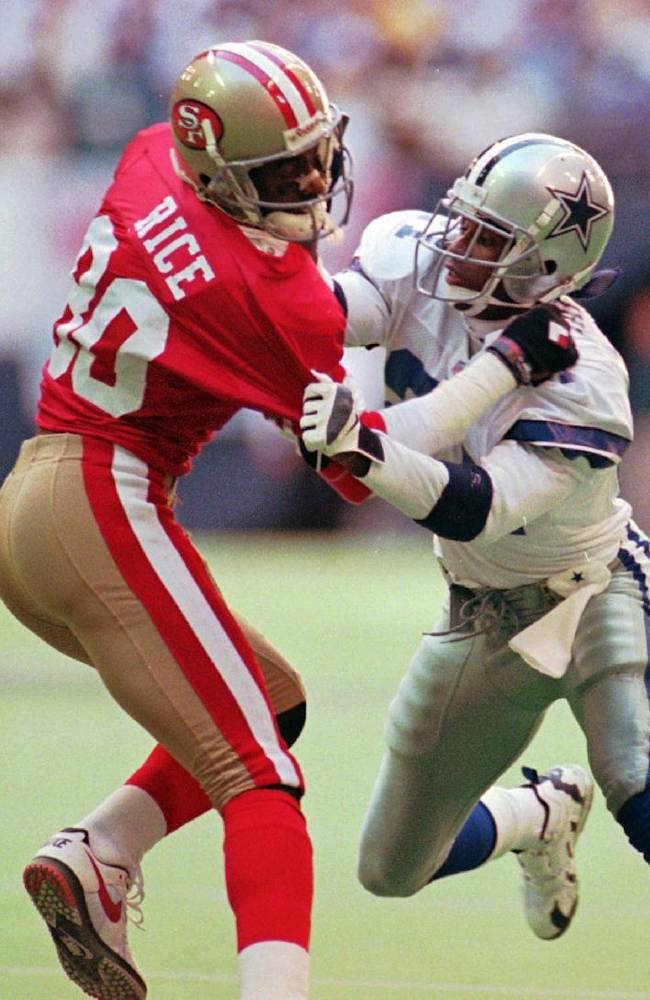 In this Nov. 12, 1995, file photo, San Francisco 49ers' Jerry Rice (80) and Dallas Cowboys defender Deion Sanders, right, battle in the first  quarter of an NFL football game in Irving, Texas. The Rice-Sanders rivalry is just one of several moves the NFL is using to try to rekindle interest in the Pro Bowl, set for Sunday in Hawaii. The NFL greats Deion will start the process of selecting Pro Bowl teams in the All-Star game's new format in which the two conferences no longer play each other