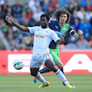 Swansea City's Wilfried Bony, left, battles for the ball with Newcastle United's Fabricio Coloccini during their English Premier League soccer match at the Liberty Stadium, Swansea, Wales, Saturday, Oct. 4, 2014