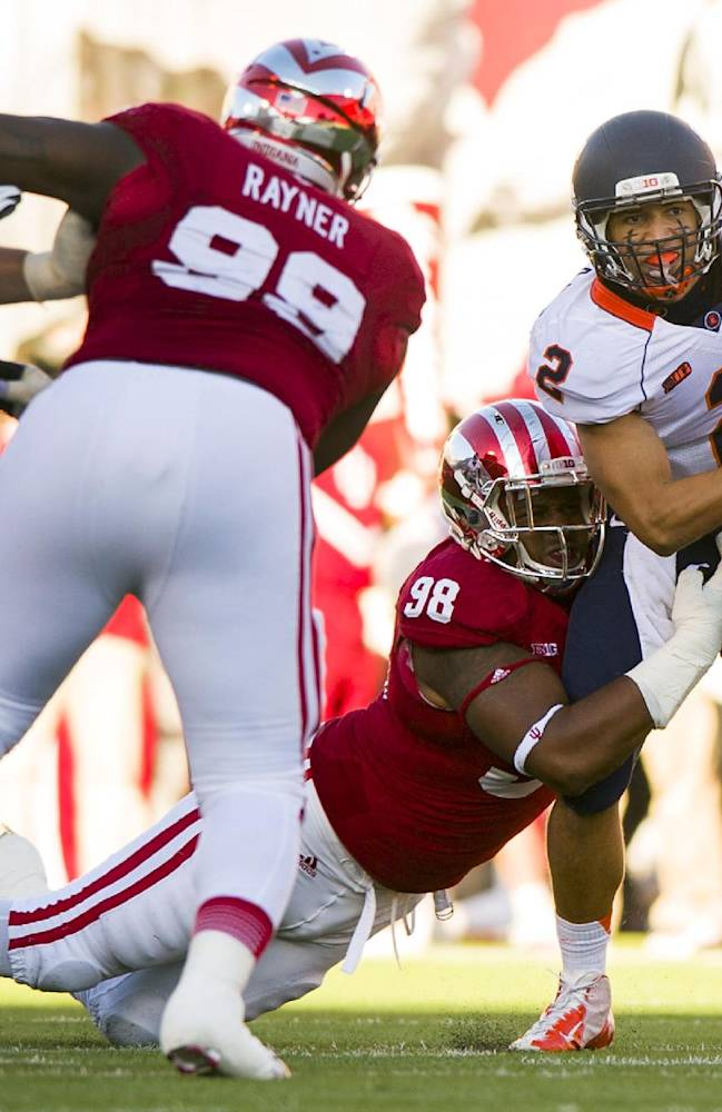 Illinois' Nathan Scheelhaase (2) is tackled by Indiana's Darius Latham (98) during the first half of an NCAA college football game, Saturday, Nov. 9, 2013, in Bloomington, Ind