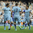 Manchester City's Frank Lampard left, celebrates with team-mates James Milner centre, and David Silva after he scores the equalizing goal for his side during their English Premier League soccer match against Chelsea at the Etihad Stadium in Manchester, En