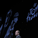 Tour de France director Christian Prudhomme, delivers his speech during the presentation of the Tour de France 2015 cycling race, in Paris, Wednesday, Oct. 22, 2014. Starting in Utrecht, Netherlands, on July 4 2015, the 102th Tour ends 22 days later, as is traditional, on the Champs-Elysees in Paris. (AP Photo/Christophe Ena)