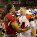 Arizona Cardinals wide receiver Larry Fitzgerald (11) greets Cincinnati Bengals quarterback Andy Dalton (14) after an NFL preseason football game, Sunday, Aug. 24, 2014, in Glendale, Ariz. The Bengals won 19-13 The Associated Press