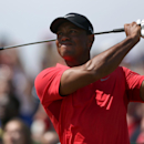 Tiger Woods of the US plays a shot off the 16th tee during the final round of the British Open Golf championship at the Royal Liverpool golf club, Hoylake, England, Sunday July 20, 2014