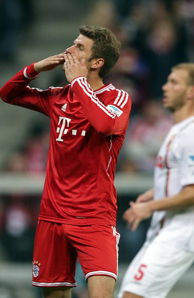 Bayern's Thomas Mueller celebrates after scoring a penalty during the German first division Bundesliga soccer match between FC Bayern Munich and FC Augsburg, in Munich, southern Germany, Saturday, Nov. 9 2013