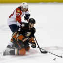 Anaheim Ducks defenseman Bryan Allen, right, battles Florida Panthers right wing Shawn Thornton for the puck during the third period of an NHL hockey game in Anaheim, Calif., Sunday, Nov. 16, 2014 The Associated Press