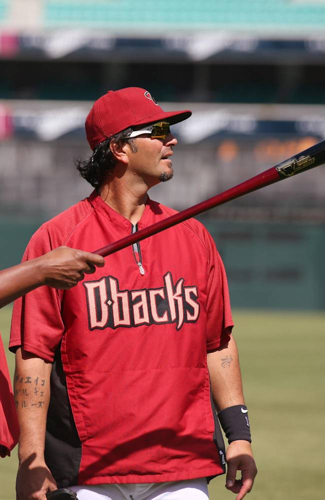 The Arizona Diamondbacks' Eric Chavez, right and pitching coach Mike Harkey look around Sydney Cricket Ground in Sydney, Wednesday, March 19, 2014. The MLB season-opening two-game series between the Dodgers and Diamondbacks in Sydney will be played this weekend