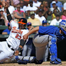 Baltimore Orioles' Nelson Cruz (23) scores behind Toronto Blue Jays catcher Josh Thole on a double by Chris Davis during the third inning of an exhibition spring training baseball game in Sarasota, Fla., Saturday, March 1, 2014 The Associated Press