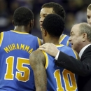 UCLA head coach Ben Howland talks with players, including Shabazz Muhammad (15), and Larry Drew II (10) late in the second half of an NCAA college basketball game against Washington, Saturday, March 9, 2013, in Seattle. UCLA beat Washington 61-54. (AP Photo/Ted S. Warren)