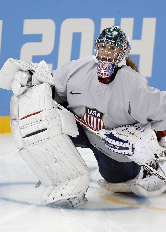 Jessie Vetter, goalkeeper of the U.S. women's ice hockey team, stretches during a practice session ahead of the 2014 Winter Olympics, Thursday, Feb. 6, 2014, in Sochi, Russia