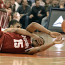 Indiana's Devin Davis passes a loose ball against Syracuse's Michael Gbinije during the first half of an NCAA college basketball game in Syracuse, N.Y., Tuesday, Dec. 3, 2013. (AP Photo/Kevin Rivoli)