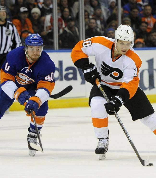 Philadelphia Flyers' Brayden Schenn (10) drives the puck down ice away from New York Islanders' Michael Grabner (40) in the third period of an NHL hockey game at the Nassau Coliseum on Saturday, Oct. 26, 2013, in Uniondale, N.Y. The Flyers won 5-2