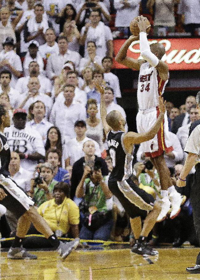 In this June 19, 2013 file photo, Miami Heat shooting guard Ray Allen (34) shoots a three-point basket in the final seconds of regulation during the second half of Game 6 of the NBA Finals basketball game against the San Antonio Spurs, in Miami. Allen's shot sent the game into overtime. For Ray Allen, it was The Summer of The Shot. Everywhere he went, all anyone wanted to talk to him about was the 3-pointer with 5.2 seconds left in Game 6 of the NBA Finals, the one that saved the Miami Heat title chances. And Allen didn't mind one bit, but even he says it's time to get ready for a new year