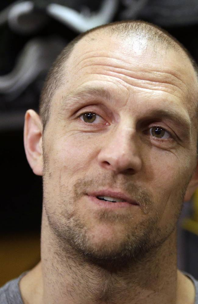 Boston Bruins defenseman Dennis Seidenberg, of Germany, speaks to the media in the team's locker room at TD Garden Friday, May 16, 2014, in Boston. The Montreal Canadiens eliminated the Bruins with a 3-1 win in Game 7 of their second-round Stanley Cup playoff NHL hockey series on Wednesday