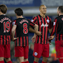 Queens Park Rangers players including Bobby Zamora, second right, prepare to defend a free kick during the English Premier League soccer match between Everton and Queens Park Rangers at Goodison Park Stadium, Liverpool, England, Monday Dec. 15, 2014