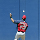 Cleveland Indians center fielder Michael Brantley can't catch up to a bases loaded triple off the bat of San Diego Padres' Yonder Alonso in the thrid inning of a spring training exhibition baseball game, Saturday, March 29, 2014, in San Diego The Associa