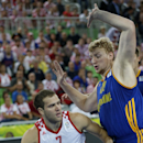 Ukraine's Kyryl Natyazhko, right, tries to stop Croatia's Bojan Bogdanovic, left, during their EuroBasket European Basketball Championship quarterfinal match in Ljubljana, Slovenia, Thursday, Sept. 19, 2013. (AP Photo/Petr David Josek)