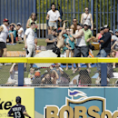 Seattle Mariners' Dustin Ackley (13) watches as fans go for a three-run home run hit by Chicago White Sox's Marcus Semien during the second inning of a spring exhibition baseball game Monday, March 24, 2014, in Peoria, Ariz The Associated Press